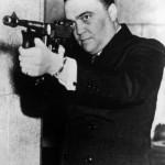 j-edgar-hoover-aiming-a-thompson-submachine-gun_i-G-27-2778-83NTD00Z